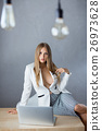 Sexy businesswoman on working place with laptop 26973628