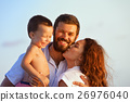 Happy family - father, mother, baby on sunset beach 26976040