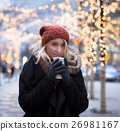 Young attractive woman in cold winter day 26981167