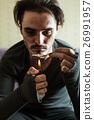 Addict in depression preparing dose of heroin. 26991957