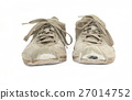 A pair of worn sneakers isolated on white 27014752
