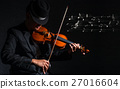 Violin player in dark studio with music notes, Musical concept 27016604