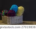 Wicker basket holding yarn. 27019836