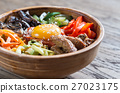 Bowl of bibimbap on the wooden table 27023175