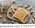 Sandwich with peanut butter on the wooden board 27027477