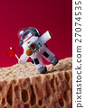 Spaceman explores Mars. Light bulb toy dressed in 27074535