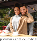 woman and man in domestic wear smiling 27085610