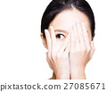 young woman covering her eyes by hands 27085671