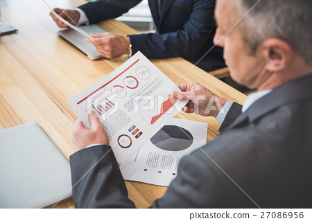 Calm businessman is holding document 27086956