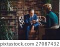 Kind female psychologist giving napkin 27087432