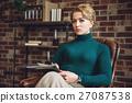 Serious woman looking at camera 27087538