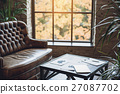 Small table in front of window 27087702