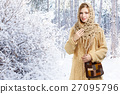 Young smiling stylish woman in openwork shawl and long beige swe 27095796