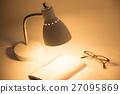 reading book under desk lump at nigjt 27095869