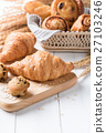 Homemade croissant  on white wood background 27103246