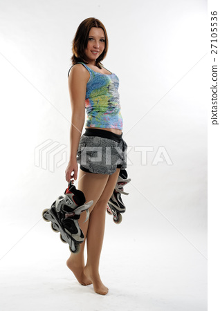 Young pretty woman with roller skates 27105536
