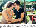 couple sitting in a cafe outside 27120026