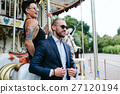adult man and woman on a carousel 27120194
