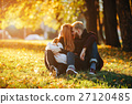young family and newborn son in autumn park 27120485