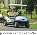 Golf carts on a golf course 27125267