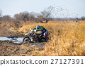 Enduro bike rider stuck in the mud 27127391