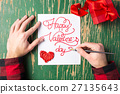 Male hands writing a Valentines day card 27135643