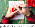 Male hands writing a Valentines day card 27135645