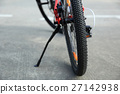 closeup of mountain bike at parking lot 27142938