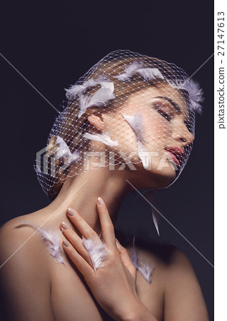 Beautiful girl in veil with feathers 27147613