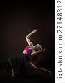 Young beautiful dancer in beige dress dancing on 27148312