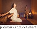 Serene girl enjoying thai massage 27150474