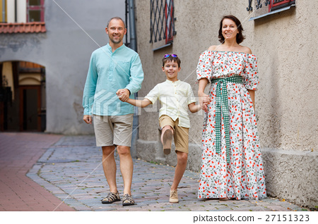 Happy young family in city street 27151323
