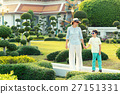 Young mother and her little son walking in Green 27151331