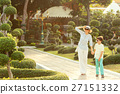 Young mother and her little son walking in Green 27151332