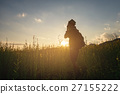 Silhouette of a young who like to travel and photographer, takin 27155222