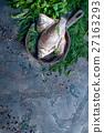 Delicious fresh fish on dark vintage background. 27163293