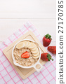 Healthy oatmeal with banana slices and strawberry 27170785