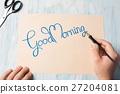Writing a good morning note top view 27204081