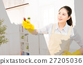 woman in gloves cleaning window 27205036