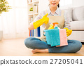housewife holding bucket showing thumbs up 27205041