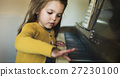 Adorable Cute Girl Playing Piano Concept 27230100