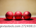 Christmas balls on snow over red background 27240813