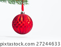 Red pattern ball hanging a tree 27244633