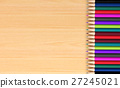 Colored pencils on wooden board for background 27245021