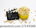 Popcorn with clapperboard on a white 27245086