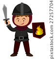 Boy in knight outfit holding sword 27257704