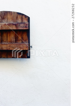 Wooden shutters on the hook against a white wall 27268232