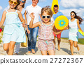 Multiracial group of friends walking at the beach 27272367