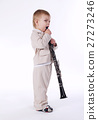 little boy with clarinet isolated 27273246