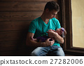 father with newborn baby in hands 27282006